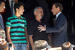 Syrian refugee, Osama Abdul Mohosen with his son Mohamad and Emilio Butragueño, Director of Institutional Relations of the club, during Real Madrid vs Granada, La Liga match. September 19,2015. (ALTERPHOTOS/Acero)
