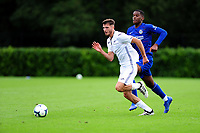 Luke Motruk of Swansea City vies for possession with Pierre Ekwah of Chelsea FC during the Premier League u18 match between Swansea City AFC and Chelsea FC at Landore Training Ground, Wales, UK. Tuesday 11th September 2018