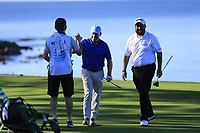 Shane Lowry (IRL) celebrates as playing partner Gerry McManus chips in on the 5th green at Pebble Beach course during Friday's Round 2 of the 2018 AT&amp;T Pebble Beach Pro-Am, held over 3 courses Pebble Beach, Spyglass Hill and Monterey, California, USA. 9th February 2018.<br /> Picture: Eoin Clarke | Golffile<br /> <br /> <br /> All photos usage must carry mandatory copyright credit (&copy; Golffile | Eoin Clarke)