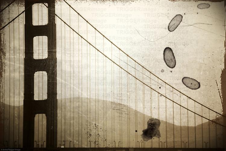 The vintage photograph of a pillar of the Golden Gate Bridge in misty rain.