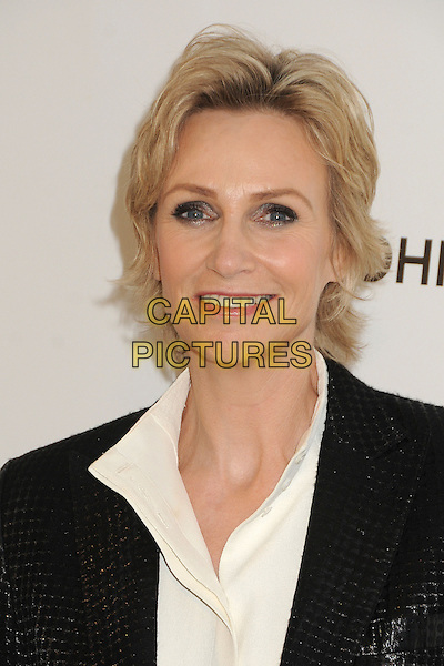 Jane Lynch.21st Annual Elton John Academy Awards Viewing Party held at West Hollywood Park, West Hollywood, California, USA..February 24th, 2013.oscars headshot portrait black shirt suit white.CAP/ADM/BP.©Byron Purvis/AdMedia/Capital Pictures.