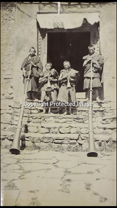 BNPS.co.uk (01202 558833)<br /> Pic: HAldridge/BNPS<br /> <br /> ***Please Use Full Byline***<br /> <br /> Young monks with there temple horns.<br /> <br /> The vendor also had a series of old pictures from the controversial Younghusband expedition.<br /> <br /> A man who took an old silver teapot along to TV's Flog It is celebrating today after it led to a record 140,000 pounds sale.<br /> <br /> Experts on the BBC show valued the item, that originated from the Far East, at 120 pounds, prompting the owner to reveal he had five other heirlooms at home.<br /> <br /> After digging the relics out he sold them at auction for the six figure sum, setting a record for the highest amount ever achieved on the popular programme.<br /> <br /> The show is very much like the Antiques Roadshow except that people go on to sell their treasures at auction which is also filmed by the Beeb.<br /> <br /> The unnamed owner took the 12ins tall teapot along to a valuation day held last month at Longleat House, Wilts.