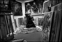 **FOR SYLVA COLUMN**.Raphael Delgado (cq), 26, wipes the sweat from his forehead while putting the finishing touches on one of his paintings in his Midtown studio on Wednesday, May 2, 2007. Sacramento Bee/ Kevin German