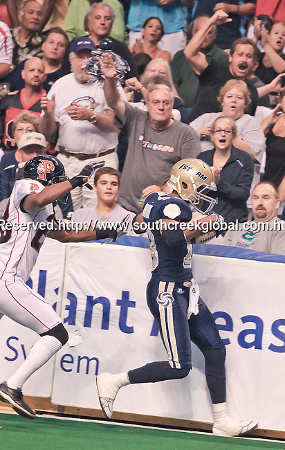 Aug 14, 2010: Tampa Bay Storm wide receiver DeAndrew Rubin (#13) catches a touchdown pass. The Storm defeated the Predators 63-62 to win the division title at the St. Petersburg Times Forum in Tampa, Florida. (Mandatory Credit:  Margaret Bowles)