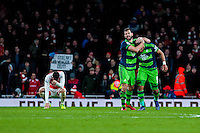 Jordi Amat of Swansea City  and Ashley Williams of Swansea City  Celebrate after final whistle at the Barclays Premier League match between Arsenal and Swansea City at the Emirates Stadium, London, UK, Wednesday 02 March 2016
