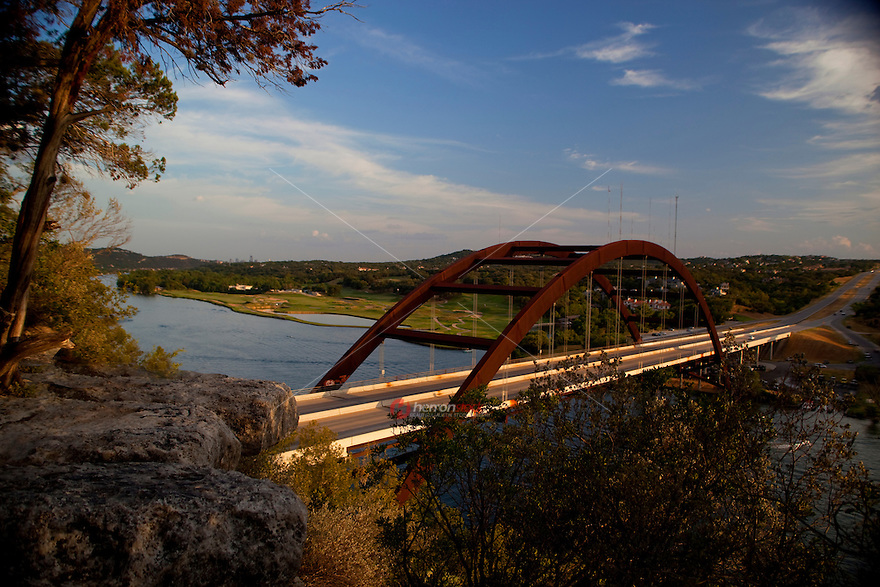 The 360 Bridge (Pennybacker Bridge) a favorite Austin attraction amid  hills and lake austin, Texas, USA