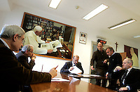 Riunione di redazione pomeridiana all'Osservatore Romano, Citta' del Vaticano, 10 marzo 2009. Terzo da sinistra, il direttore Giovanni Maria Vian. Sullo sfondo, un ritratto di Papa Benedetto XVI..Vatican newspaper L'Osservatore Romano director Giovanni Maria Vian, third from left, leads the editorial office meeting, at the Vatican City, 10 march 2009. On background, a portrait of Pope Benedict XVI is seen..UPDATE IMAGES PRESS/Riccardo De Luca