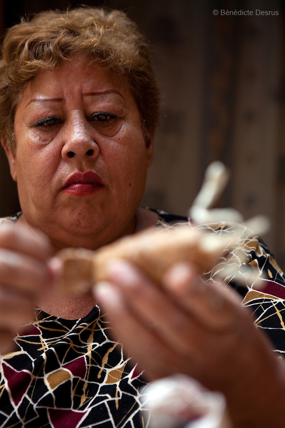Lourdes, resident of Casa Xochiquetzal, makes catrinas to sell and make money to support the shelter in Mexico City, Mexico on October 7, 2010. Catrinas are popular figures used during the Day of the Dead celebrations in Mexico. Casa Xochiquetzal is a shelter for elderly sex workers in Mexico City. It gives the women refuge, food, health services, a space to learn about their human rights and courses to help them rediscover their self-confidence and deal with traumatic aspects of their lives. Casa Xochiquetzal provides a space to age with dignity for a group of vulnerable women who are often invisible to society at large. It is the only such shelter existing in Latin America. Photo by Bénédicte Desrus