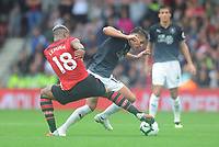Burnley's Ashley Westwood is tackled by Southampton's Mario Lemina<br /> <br /> Photographer Kevin Barnes/CameraSport<br /> <br /> The Premier League - Southampton v Burnley - Sunday August 12th 2018 - St Mary's Stadium - Southampton<br /> <br /> World Copyright &copy; 2018 CameraSport. All rights reserved. 43 Linden Ave. Countesthorpe. Leicester. England. LE8 5PG - Tel: +44 (0) 116 277 4147 - admin@camerasport.com - www.camerasport.com