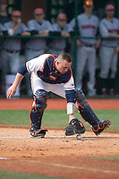 Virginia Cavaliers catcher Matt Thaiss (21) fields the ball out in front of home plate during the game against the Hartford Hawks at The Ripken Experience on February 27, 2015 in Myrtle Beach, South Carolina.  The Cavaliers defeated the Hawks 5-1.  (Brian Westerholt/Four Seam Images)
