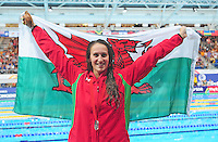 Wales' Georgia Davies poses with a Welsh flag after taking the silver medal place on the podium in the women's 100m backstroke final when she finished second<br /> <br /> Photographer Chris Vaughan/CameraSport<br /> <br /> 20th Commonwealth Games - Day 3 - Saturday 26th July 2014 - Swimming - Tollcross International Swimming Centre - Glasgow - UK<br /> <br /> © CameraSport - 43 Linden Ave. Countesthorpe. Leicester. England. LE8 5PG - Tel: +44 (0) 116 277 4147 - admin@camerasport.com - www.camerasport.com