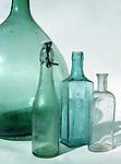 Four different shaped antique bottles.