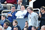 Newcastle owner Mike Ashley looks pleased during the Barclays Premier League match at St James' Park. Photo credit should read: Philip Oldham/Sportimage
