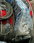 Professional Rodeo Cowboy Association pick up men working for Harry Vold Rodeo Company endured muddy conditions in the Frontier Park Arena during the 2007 Cheyenne Frontier Days Rodeo to protect the cowboys and stock competing.
