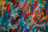 """An abstract texture is seen on the scribbled wall in the sign painting workshop in Cartagena, Colombia, 14 April 2018. Hidden in the dark, narrow alleys of Bazurto market, a group of dozen young men gathered around José Corredor (""""Runner""""), the master painter, produce every day hundreds of hand-painted posters. Although the vast majority of the production is designed for a cheap visual promotion of popular Champeta music parties, held every weekend around the city, Runner and his apprentices also create other graphic design artworks, based on brush lettering technique. Using simple brushes and bright paints, the artisanal workshop keeps the traditional sign painting art alive."""