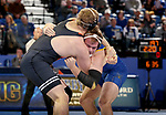 BROOKINGS, SD - NOVEMBER 17: Samuel Grove from South Dakota State University battles with Preston Weigel from Oklahoma State University during their 197 pound match Saturday night at Frost Arena in Brookings. (Photo by Dave Eggen/Inertia)