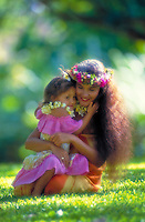 Mother wearing a haku headband and daughter in outdoor park setting