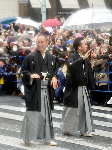 March 27, 2013, Tokyo, Japan - Ichikawa Ebizo, left, and Ichikawa Ennosuke greet fans as some 60 leading Kabuki actors parade in the rain through the main street of Tokyo's Ginza shopping district on Wednesday, March 27, 2013, in celebration of the grand opening of new Kabuki theater. After three years of renovation, the majestic theater for Japan's centuries-old performing arts of Kabuki will open its doors to the public with a three-month series of most sought-after plays.  (Photo by Natsuki Sakai/AFLO)