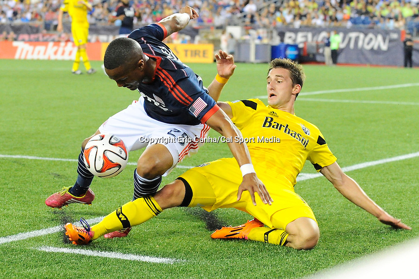 July 26, 2014 - Foxborough, Massachusetts, U.S. - New England Revolution defender Darrius Barnes (25) and Columbus Crew midfielder Ethan Finlay (13) go down battling for the ball during the MLS game between the Columbus Crew and the New England Revolution held at Gillette Stadium in Foxborough Massachusetts.  Eric Canha/CSM