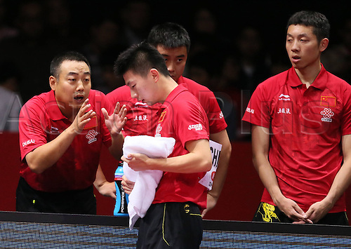 05.05.2014. Tokyo, Japan.  Head coach of China Liu Guoliang (L) gives instructions to Ma Long during the men s group final match against Germany in Zen Noh 2014 World Table Tennis Championships in Tokyo, Japan, May 5, 2014. China won 3-1 and claimed the title of the event.