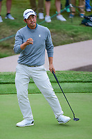 John Huh (USA) sinks his birdie putt on 18 to reach 7 under  during round 3 of the Valero Texas Open, AT&amp;T Oaks Course, TPC San Antonio, San Antonio, Texas, USA. 4/22/2017.<br /> Picture: Golffile | Ken Murray<br /> <br /> <br /> All photo usage must carry mandatory copyright credit (&copy; Golffile | Ken Murray)