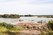 Xingu River, Para State, Brazil. The Volta Grande; Aldeia Terra Wangã da Volta Grande - Maia, Arara ethnic group. Low river level, rocks.