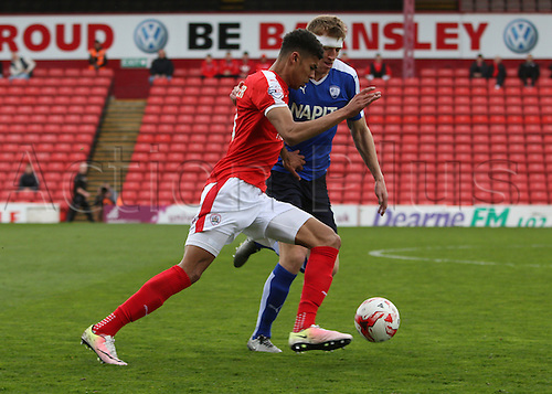 09.04.2016. Oakwell, Barnsley, England. Skybet League One. Barnsley versus Chesterfield. Barnsley's Ashley Fletcher trys to get the ball past defender Tom Anderson