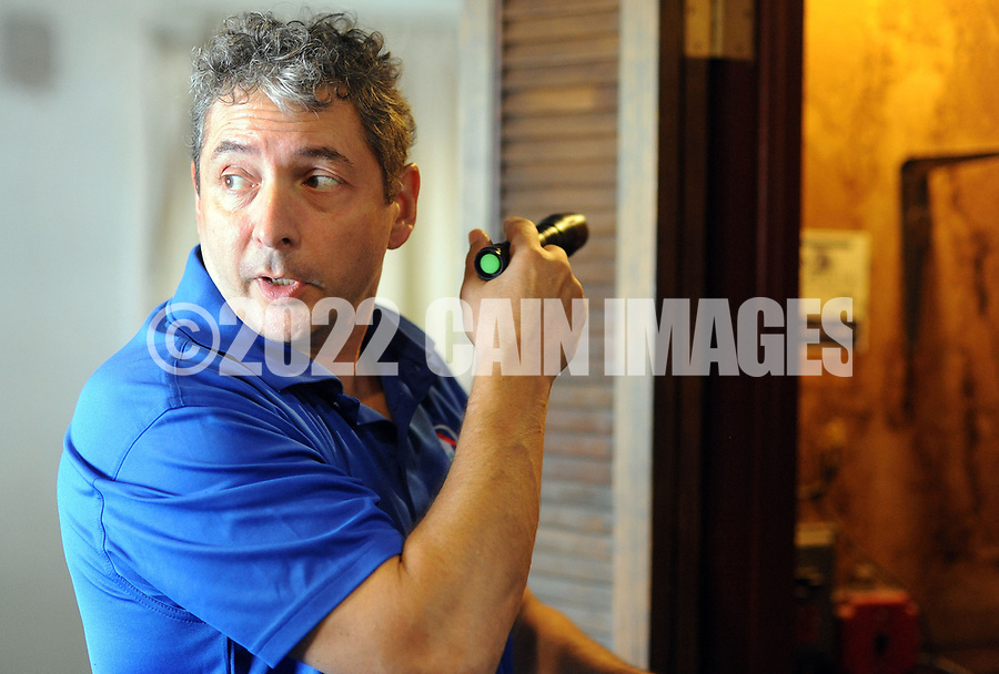 Home inspector Frank Castiglione of Real Estate Inspections, answers a question as looks at the living room of a home for possible problems Thursday, September 28, 2017 in Plymouth Meeting, Pennsylvania. (WILLIAM THOMAS CAIN / For The Philadelphia Inquirer)