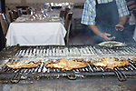 Grilled fish at Mercado do Peixe restaurant in Lisbon, Portugal