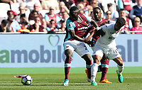 Wayne Routledge of Swansea City challenges Arthur Masuaku of West Ham United during the Premier League match between West Ham United and Swansea City at the London Stadium, England, UK. 08 April 2017