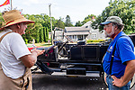 WOODBURY, CT. 16 July 2019-071619 - Richard Elderkin of Middlebury, left, talks to Kelly Williams of Mount Joy, Penn owner of his 1914 607 Stanley Steamer that sits in front of them at the Hotchkissville Firehouse in Woodbury on Tuesday. The Steamers need to stop every 35-50 miles to fill up with water as they operate by steam. A large group of owners of Stanley Steamers from around the country have gathered driving around the area touring the Litchfield Hills. Bill Shettle Republican-American