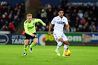 SWANSEA, WALES - JANUARY 19: Mark Duffy of Sheffield United battles with Wayne Routledge of Swansea City during the Sky Bet Championship match between Swansea City and Sheffield United at the Liberty Stadium on January 19, 2019 in Swansea, Wales. (Photo by Athena Pictures/Getty Images)