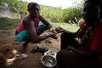 "two girls, former Quiza ( a mixture of cocaine and other drugs, smoked like crack ) addict, have lunch  at ""Desafio Jovem"" a rehabilitation community in the outskirts of Bissau, Guinea Bissau on Sunday Sept 16 2007.///..Guinea Bissau is infamous for its cocaine trafficking. in 2005 Colombian cartels begun to arrive in the country transforming it into a Narco State. Up to 5 tons of pure cocaine are estimated to be arriving in the country every week. Guinea Bissau is the 5th poorest country in the world, making it the ideal transit base for the cocaine that will finish on the european markets. Corruption and involvement in the trafficking are present at every level of its institutions..Guinea Bissau is only one of the countries in West Africa involved in cocaine trafficking. Tons of Cocaine have been seized in Nigeria, Senegal, Ghana and  Sierra Leone."
