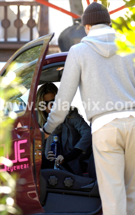 **ALL ROUND PICTURES FROM SOLARPIX.COM**.SYNDICATION RIGHTS FOR UK, CANADA, USA, SOUTH AFRICA, SOUTH AMERICA, DUBAI, AUSTRALIA, NEW ZEALAND, GREECE, ASIA.Brasilian supermodel, Gisele Bundchen leaves the Spanish island of Ibiza with her boyfriend Tom Brady, and a bottle of mineral water to go to the airport..JOB REF:     6040    SPA     DATE:  28.03.08.**MUST CREDIT SOLARPIX.COM OR DOUBLE FEE WILL BE CHARGED* *UNDER NO CIRCUMSTANCES IS THIS IMAGE TO BE REPRODUCED FOR ANY ONLINE EDITION WITHOUT PRIOR PERMISSION*