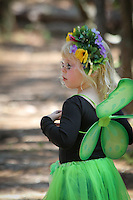 Six-year-old Claire Sequin,Cape Coral, plays in the woods during the third annual Florida Faerie Festival in Bonita Springs, Florida, USA, March 19, 2011. Photo by Debi Pittman Wilkey