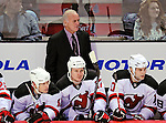 9 January 2010: New Jersey Devils Head Coach Jacques Lemaire looks out from behind the bench during a game against the Montreal Canadiens at the Bell Centre in Montreal, Quebec, Canada. The Devils edged out the Canadiens 2-1 in overtime. Mandatory Credit: Ed Wolfstein Photo