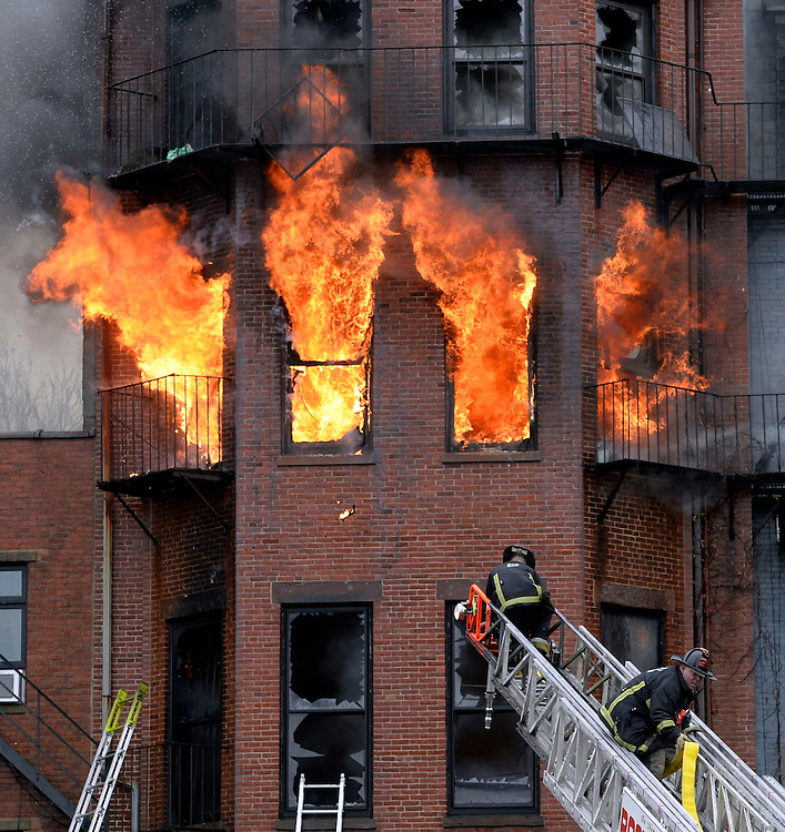 (Boston, MA, 03/26/14) Two firefighters were killed when a massive 9-alarm, wind-whipped fire in Boston's Back Bay trapped them in the basement of a four-story building<br /> on Wednesday, March 26, 2014. Photo by Christopher Evans