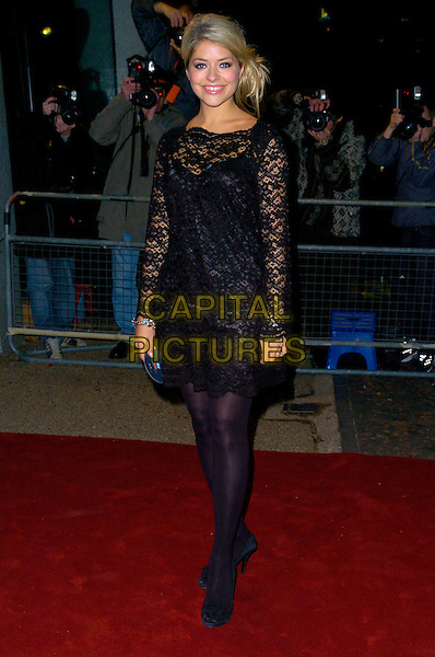 "HOLLY WILLOUGHBY.Arrives at ""An Audience With Take That"".at The London Television Studios,.London, England, December 2nd 2006..full length black lace tunic dress tights shoes.CAP/CAN.©Can Nguyen/Capital Pictures"