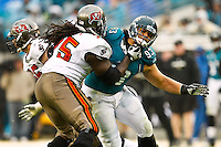 December 11, 2011:  Jacksonville Jaguars defensive tackle Tyson Alualu (93) tries to fight through the block of Tampa Bay Buccaneers guard Davin Joseph (75) during second half action between the Jacksonville Jaguars and the Tampa Bay Buccaneers played at EverBank Field in Jacksonville, Florida.  Jacksonville defeated Tamp Bay 41-14.........