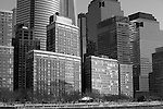 """""""Downtown"""" Black and White Downtown Manhattan New York. The New World Trade Center Tower is the wide skyscraper in the left -middle of the photograph. I shot this Downtown Manhattan Skyline scene while on a boat tour in the days before the worst storm in 20 years blew in lasting three days. The strong winds made it difficult to stay warm, hold my camera stable on my monopod and stay out of the water spray from the waves created by the boat. The New World Trade Center tower was just finishing construction at the top and rises high above the other skyscrapers. During the storm Governors in surrounding states and New York banned driving personal vehicles on the public highways for a couple days.  Being from Lake Tahoe I came prepared for the weather and was excited to capture New York City and Central Park with fresh snow. The incredible skyline of Manhattan was breathtaking. Growing up in California, visiting San Francisco as an adult regularly and shooting it many times as a professional photographer didn't prepare me for the magnitude of the impressive size and quantity of the buildings and skyscrapers that form the skyline of Manhattan. My hat is off to the Architects and Engineers who contributed to building the touted greatest city on Earth. Black and white photography is still my favorite so you will see many images offered in Color and BW."""