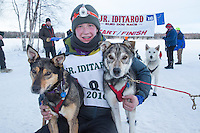Chandler Wappett with lead dogs at the finish line of the 2016 Junior Iditarod in Willow, Alaska, AK  February 28, 2016