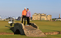 Peter Lawrie (IRL) and his playing partner Kieran McManus (AM) on the Swilcan Bridge on the 18th fairway during Round 2 of the 2015 Alfred Dunhill Links Championship at Kingsbarns in Scotland on 2/10/15.<br /> Picture: Thos Caffrey | Golffile