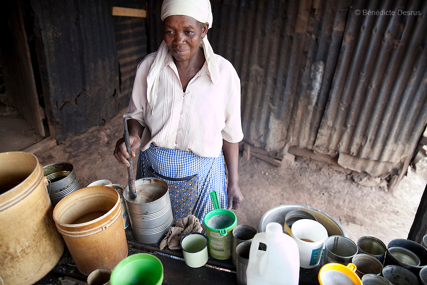 Jane Neseka, a 50 year old Kenyan woman, at the Gatina Busaa Club in a Nairobi slum on March 27, 2013. Jane has been brewing Busaa for more than 20 years, she opened the Gatina Busaa Club in 1986. Busaa is made by crudely fermenting maize, millet, sorghum or molasses. At Kshs 35 per liter it is much cheaper than a Kshs120 half-liter bottle of commercial beer. The local brew was legalised in 2010 and since then busaa clubs have become increasingly popular. Drinking is on the rise in Kenya, especially among young people. Photo: Benedicte Desrus