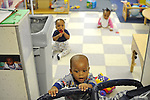 (L-r) Desmond Swanson, 1, Arlo Hollins, 8 months, and Shaniya Mason, 7 months, play in Room 121 at the Educare Early Childhood Center in Chicago on November 21, 2008.  The pre-K daycare center is a model for head start, funded privately by the Gates and other foundations, that cares for and educates infants, toddlers, and 3- and 4-year old pre-school children.