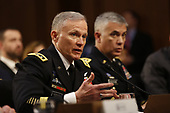 """Director General Robert Ashley, Defense Intelligence Agency (DIA) testifies before the United States Senate Select Committee on Intelligence during an open hearing on """"Worldwide Threats"""" on Capitol Hill in Washington, DC on Tuesday, January 29, 2019. looking on at right is Director General Paul Nakasone, National Security Agency (NSA).<br /> Credit: Martin H. Simon / CNP"""
