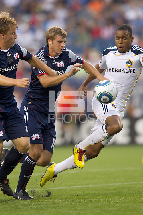 Los Angeles Galaxy forward Tristan Bowen (17) attempts to control the ball as New England Revolution midfielder Jason Griffiths (16) pressures. The New England Revolution defeated LA Galaxy, 2-0, at Gillette Stadium on July 10, 2010.