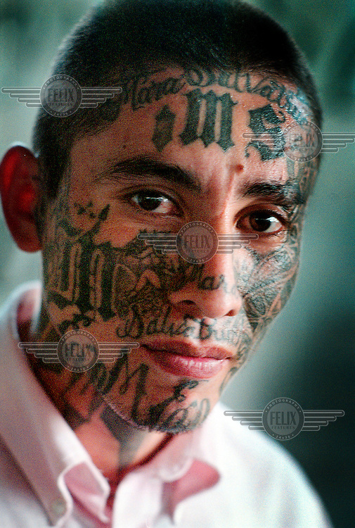 A member of the Mara Salvatrucha gang, his face and body covered with tattooes, in the special prison of Quezaltepeque. The Mara Salvatrucha gang, MS13, originated in the 1970s within the Salvadorian immigrant community of Los Angeles. With a systematic policy of deportations engaged by the United States, the gang problem has been exported back to Central America causing an explosive rise in vicious gang-related crime. Today, cities like San Salvador experience some of the highest rates of murder in the world.
