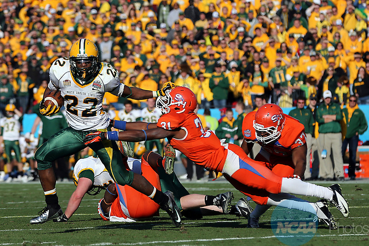 05 JAN 2013:  Sam Ojuri (22) of the North Dakota State Bison carries the ball against Michael Wade (31) of the Sam Houston State Bearkats during the Division I Men's Football Championship held at FC Dallas Stadium in Frisco, TX. North Dakota State Bison beat the Sam Houston State Bearkats 39-13.  Tom Pennington/NCAA Photos