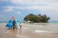 Access to Taprobane Island from the beach is usually by wading through the surf, or in this case by elephant