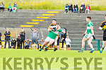 Jason Lyne  Dr Crokes makes sure Peter McCarthy Legion doesnt get in on goal during the League game in Lewis Road on Sunday